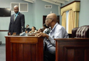 Former Senator-At-Large Robert O'Connor Jr. raises concerns about St. John while the current office holder, Steven Payne, listens. The discussion took place as part of a Town Hall meeting held Friday night in Cruz Bay.