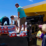 A team of Love City Strong members give out cases of water to St. John residents at the Coral Bay Fire Station.