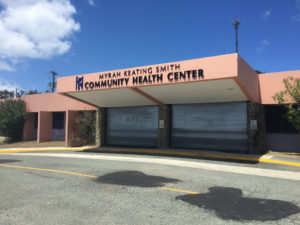 Metal service doors shutter the entrance to the Myrah Keating Smith Clinic, damaged in the 2017 hurricanes. (File photo)