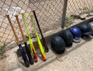 Gear for the game is lined up carefully in the D.C. Canegata Ballpark dugout. (Anne Salafia photo