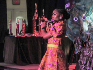 Kimorah-Lin Blackett plays the flute during the talent segment of the pageant.