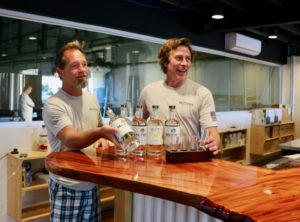 In the tasting room, which offers a clear view of the distillery, Mutiny Island co-founder Todd Manley and director of opeerations and HR Shawn Henderson offer a taste of Mutiny Island Vodka. (Linda Morland photo)