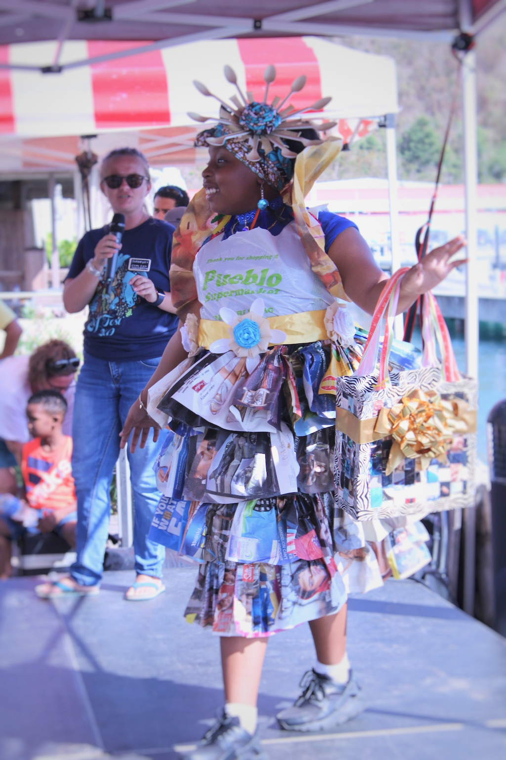 Wearing a ruffled dress made of magazines, newspapers and grocery bags, Kelyssa Kelley, graced the stage of the Trashion Show with a smile and panache. The 9-year-old represented Lockhart Elementary School and completed her outfit with a handbag and full head piece made from recycled materials.