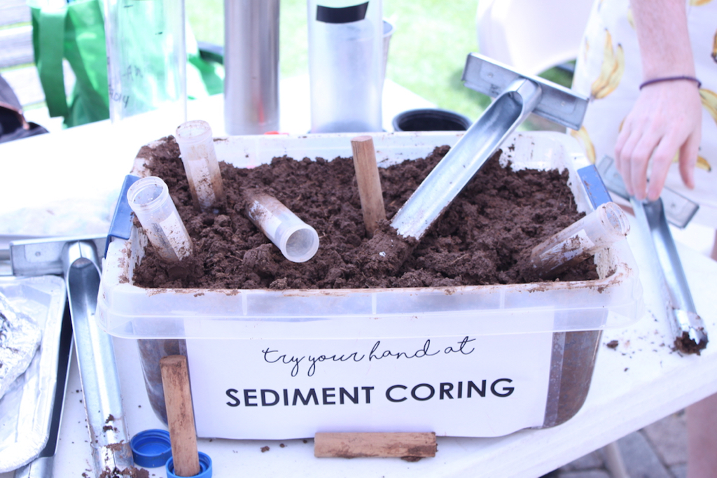 One booth for guests to interact with displayed a bin full of sand to sift through with a sign that asked if attendees know what lives on sandy beaches, while another prompted guests to try sediment coring using metal tubes. On display were data results from the 2016 Territory Beach Cleanups and the 2018 Great Mangrove Cleanup, which concluded metal bottle caps and plastic pieces to be the most frequent debris collected.