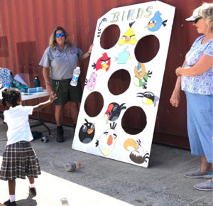 National Park Ranger Laurel Brannick has children throw bottles at a target to show how angry the birds are about plastic in the environment. (Photo by Gail Karlsson)