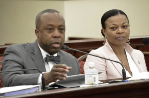 Acting Finance Commission Kirk Callwood and Acting Budget Director Jenifer O'Neal discuss plans for a budgetary windfall at Tuesday's Finance Committee hearing. (Photo by Barry Leerdam, V.I. Legislature)