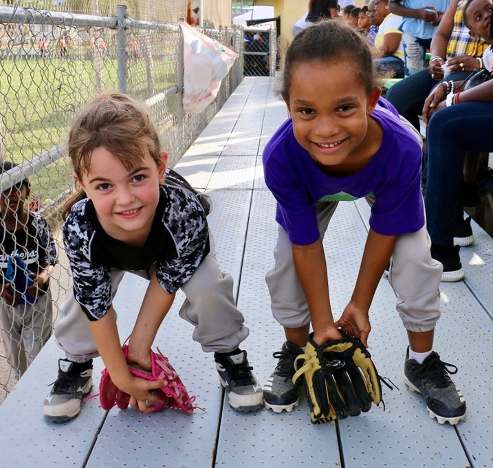 Friends and classmates at Pearl B. Larsen Elementary School, Bella Karalius, at left withg her prized pink glove, and Ta'Liyah Pop show their playing stance after the game. Bella plays for the Panthers and Ta'Liyah for Diamond Dolls. (Linda Morland photo)