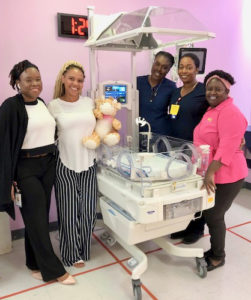 """JFL Hospital staff, from left, K. Davis, RN with unit mascot """"Jeffery,"""" J. Jeffers, RN, D. Ebbeson, RN and B. Abraham, pose with recently acquired incubator for the neonatal intensive care unit. (Submitted photo)"""