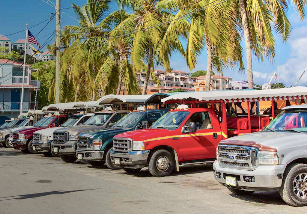Taxis line up for business on St. John. (Photo from the V.I. Taxi Association website)