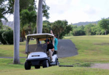 Enjoying the afternoon, golfers take a short ride to the next hole. (Linda Morland photo)