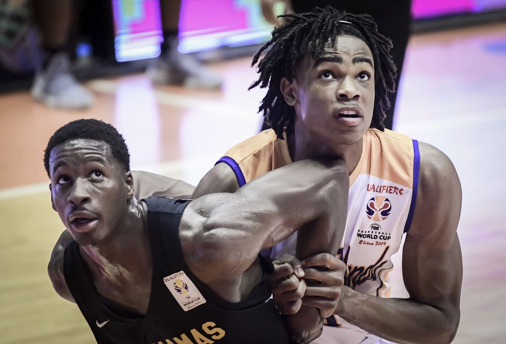 Nicolas Claxton, right, battles for a rebound during his V.I. Senior National Team Debut on June 28, 2018, versus the Bahamas. (Photo by FIBA Basketball)