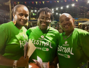 Membesville volunteers Aliah Lockhart, Alecia Wells, and Enid Doway enjoy opening night. (Source photo by Amy Roberts)