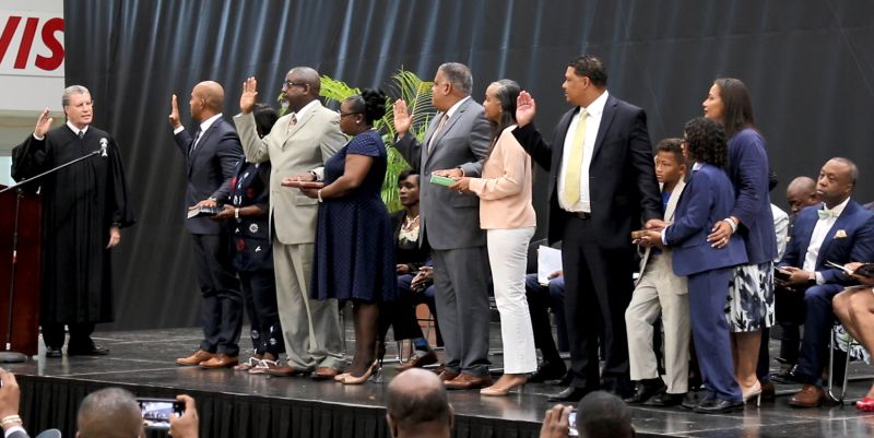 From left: V.I. Supreme Court Chief Justice Rhys S. Hodge administers the oath of office to Nelson Petty Jr., Anthony D. Thomas, Joseph Boschulte, and Jean-Pierre Oriol, surrounded by family. (James Gardner photo)