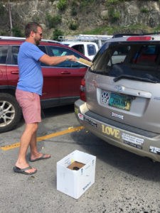 Stephen Libbey cleans glass from a co-worker's car. (Amy Roberts photo)