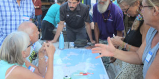 Community members at Tuesday's watershed meeting discuss areas that need remediation.