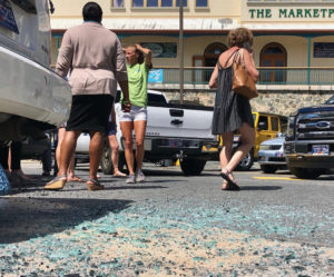 People examine the damage of the Marketplace mayhem. (Judi Shimel photo)