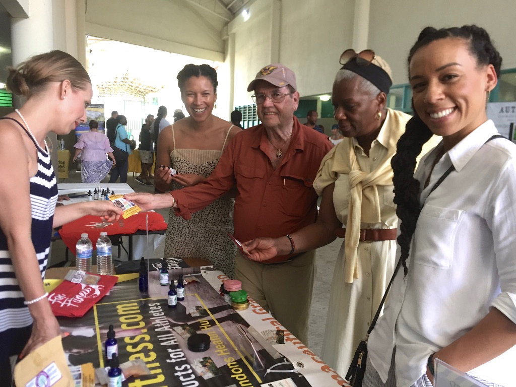 From left,speaker and vendor Sierra Riddle chats with Dr. Rachel Knox, Holland Redfield, Dr. Janice Knox and Dr. Jessica Knox at the Cannaval. (Source photo by Susan Ellis)