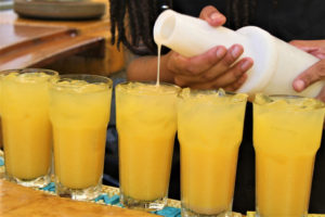 A popular, tropical drink, locally branded as the 'Painkiller,' is mixed for the food tour guests to sample. (Source photo by Bethaney Lee)
