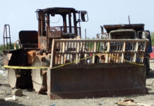 A bulldozer that was set on five June 17 at Anguilla Landfill. (Source photo by Susan Ellis)