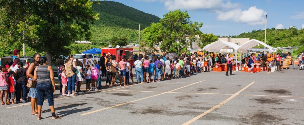 Parents and students line up to get backpacks Tuesday. (Photo by Samuel Hodges for Home Depot)