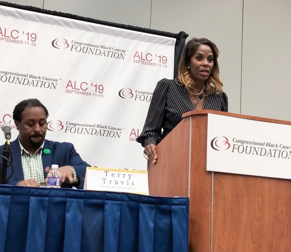 USVI Delegate to Congress Stacey Plaskett, right, welcomes attendees as EVHybridNoire co-founder Terry Travis looks on. (Source photo by April Knight)