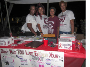 From left: Estellita Penn, Zaida Caban, Aniece Evans, and Stacie Penn collect filled out raffle tickets at the sickle cell fundraiser. (Source photo by Raven Phillips)