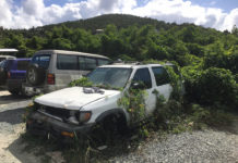 Abandoned cars such as this were removed from the lot last summer. (Source file photo by Amy Roberts)