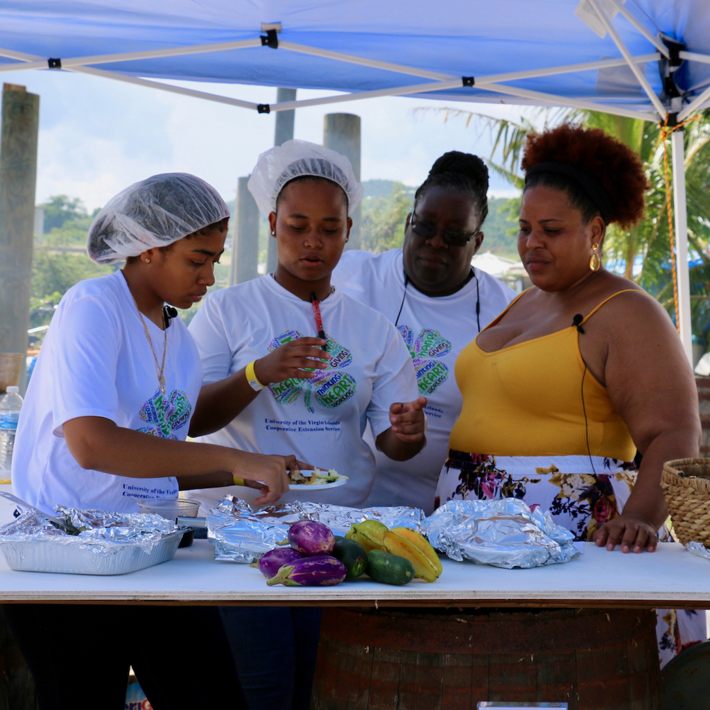Sommer Sibilly-Brown of the Virgin Islands Good Food Coalition (on right), discusses the menu prepared by the 4-H Superlicious Chefs. From left: Justic Veira, Melissa Ferreras, and Dawn Thomas. (Source photo by Linda Morland)