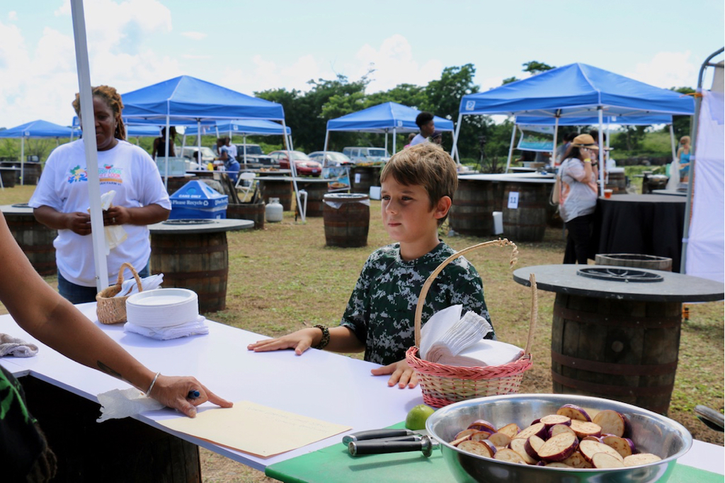 Taj Washburn collects the menus for each competitor under the watchful eye of Yvette Browne of Sejah Farm. (Source photo by Linda Morland)