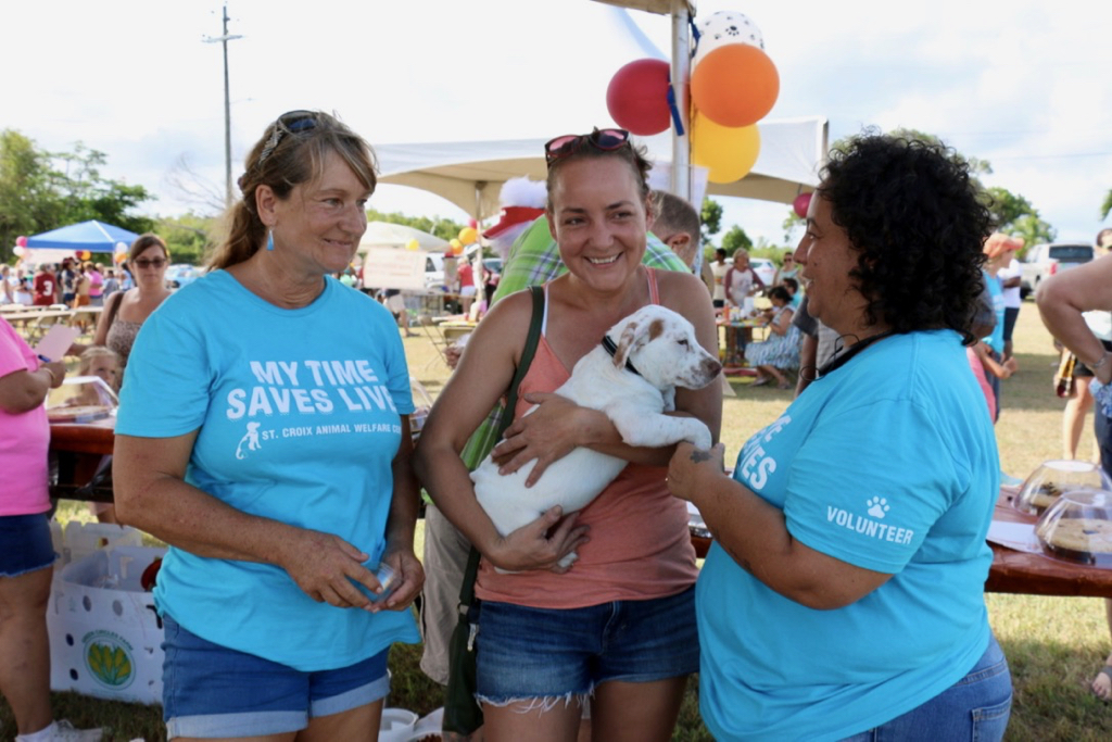 Trixi Fanelli, Dr. Michelle Mehalick, and Rosa Bellamafia discuss little Snoopy, who is available for adoption. Trixi and Rosa are among the many volunteers who make the work of SCAWC possible. Dr. Mehalick provides the medical care necessary, often evenings, nights and weekends as well as during regular office hours. (Source photo by Linda Morland)