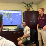 Ken Kreis, seated, and Scott Guenther show a map of the search area. (Source photo by Amy Roberts)