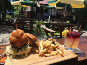 A Whiskey Burger plated on signature wood plank makes a tempting visual. (Source photo by Teddi Davis)