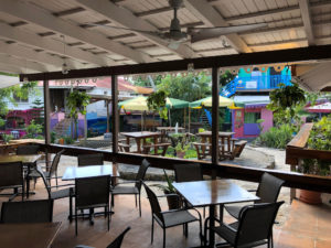 In addition to the spacious bar area, Whiskey Business offers al fresco dining and umbrella-topped table seating. (Source photo by Teddi Davis)