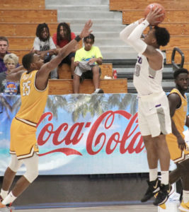 Charles Johnson, who had 27 points in Grand Canyon's opening day loss, shoots over Valparaiso's Nick Robinson Jr. (Photo by Basketball Travelers)