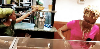 Isumyah Schrader's daughters, Ama and Amibala, serve customers. (Source photo by Darshania Domingo)