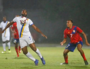 Kassall Greene controls the ball for the Virgin Islands in a recent loss against the Cayman Islands.