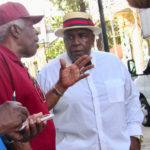 The late Carnival Committee Chairman Kenneth Blake chats with Village Committee Chairman Edgar Baker Philips at an event in 2018. Blake died Nov. 1 in Florida. (File photo)