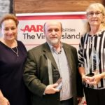 AARP CEO Jo Ann Jenkins, left, presented the Andrus Award Tuesday to Scott Bradley and Alma Winkfield. (Source photo by Linda Morland)