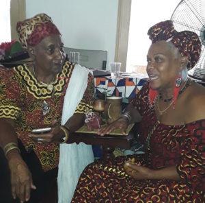 Iya Tahira, left, and Makeda Kamara, share in the Kwanzaa festivities. (Source photo by Darshania Domingo)
