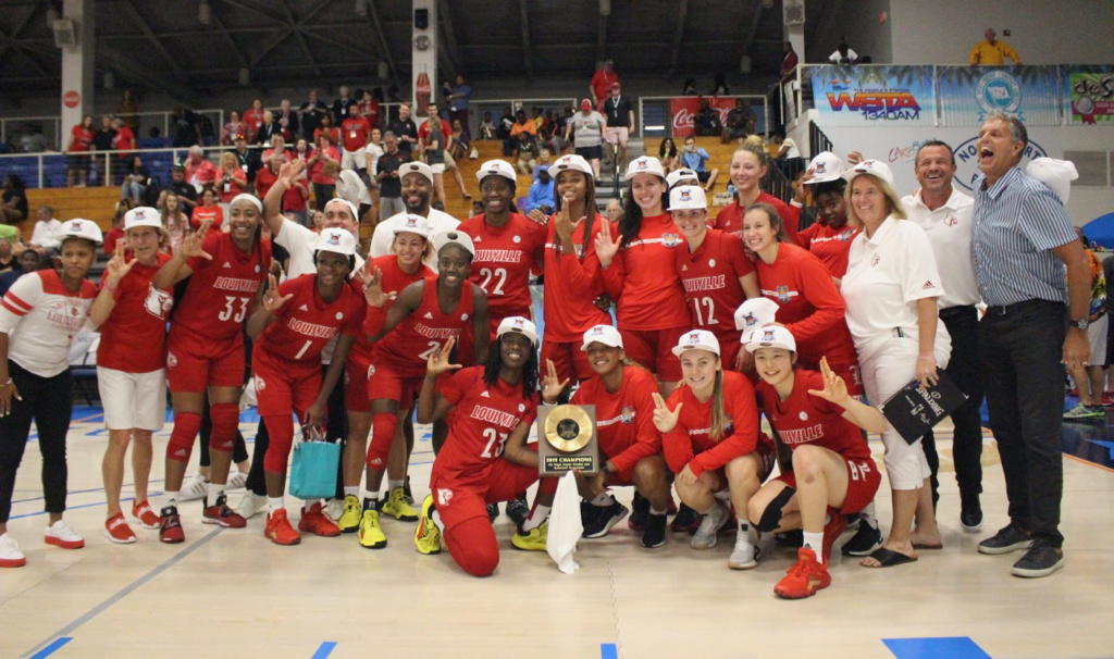 The Louisville Cardinals celebrate Saturday after capturing the Island Division in the 20th annual Paradise Jam. (Photo by Basketball Travelers)