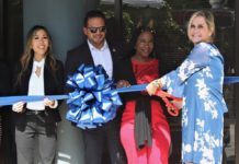 MASA Assist staff gets ready to cut the ribbon for the emergency assistance service's new location in Charlotte Amalie. From left, Janelle Ennis, Juan Gonzalez, Tara Crossley and Janet Bryant. (Source photo by Bethaney Lee)