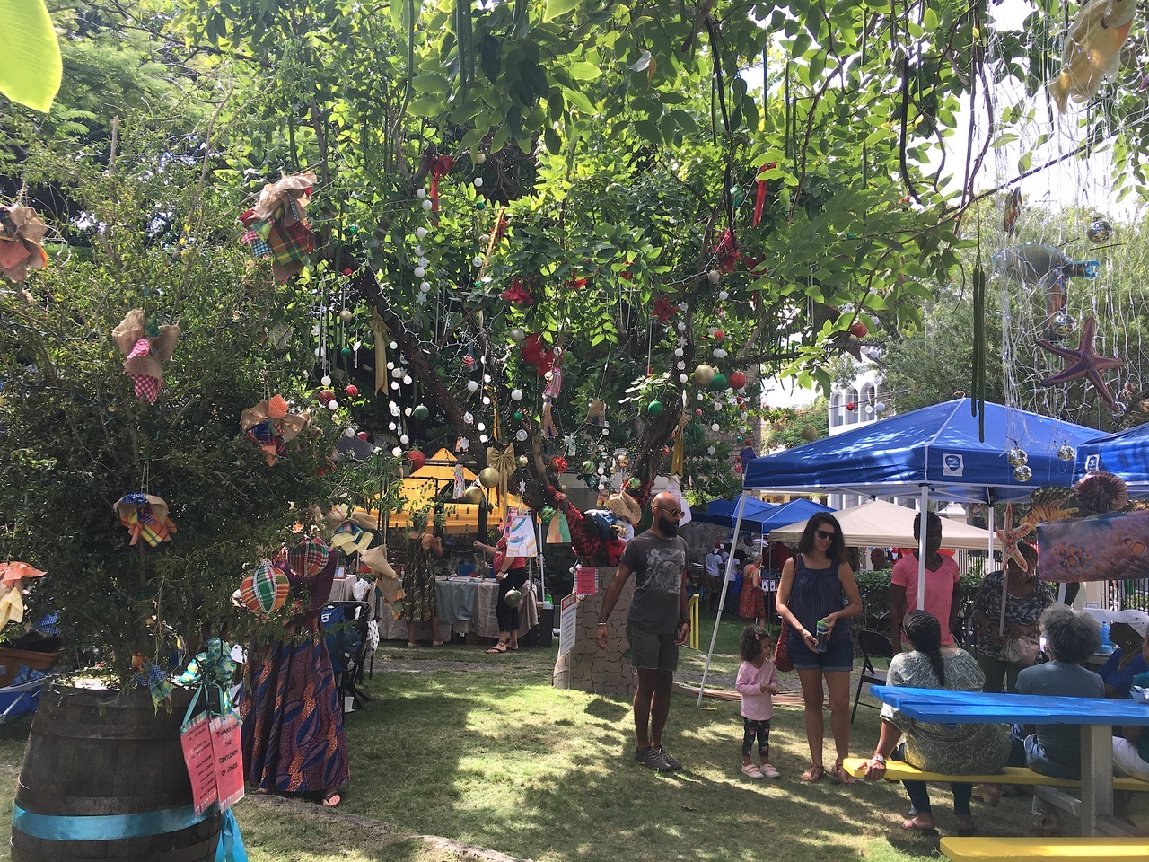 Families roamed among the decorated trees at Limpricht Park Saturday. (Source photo by Susan Ellis)