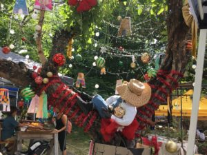 One of the decorated trees in Limpricht cradles a sleeping cowboy. (Source photo by Susan Ellis)