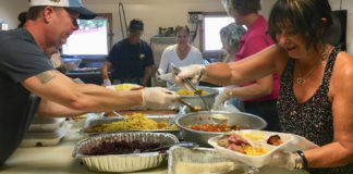 Volunteers crowd into the St. Mary's kitchen to assemble Thanksgiving dinner plates. (Source photo by Susan Ellis)
