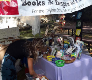 A customer looks through the wares at the Love and Light Booth. (Source Photo by Darshania Domingo)