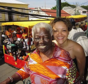 Ann Abramson and her granddaughter Rhea watch a parade pass by in Frederiksted. (Photo submitted by family)