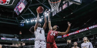Alyah Boston, No. 4 in white, puts up a shot against Arkansas.