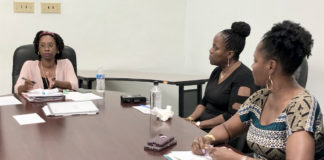 At left, Leia LaPlace, territorial planner for the V.I.Department of Planning and Natural Resources Comprehensive and Coastal Zone Planning, hears rezoning requests at the DPNR office in Frederiksted. (Source photo by Susan Ellis)