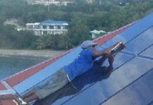 A solar installer puts in a three-rail system on St. John. (Photo provided by Caribbean Solar Company)