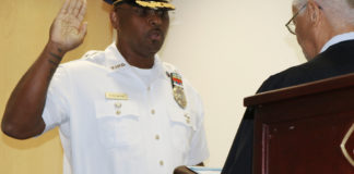Associate Supreme Court Justice Ive Arlington Swan administers the oath of office to St. Croix Police Chief Sydney Elskoe. (VIPD photos)
